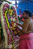 Sri Veeramakaliamman temple. SINGAPORE - FEB 24 : Indian man decorating idol in Sri Veeramakaliamman temple in Little India, Singapore on February 24 2018 It is Royalty Free Stock Image