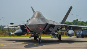 Military aircrafts for display in Singapore. Singapore - Feb 10, 2018. A Lockheed Martin F-35 Lightning II aircraft belong to the US Marine sits on display in Stock Photos