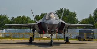 Military aircrafts for display in Singapore. Singapore - Feb 10, 2018. A Lockheed Martin F-35 Lightning II aircraft belong to the US Marine sits on display in Royalty Free Stock Image