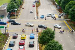 People crossing multilane road. Singapore Royalty Free Stock Photography
