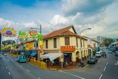 SINGAPORE, SINGAPORE - FEBRUARY 01, 2018: Above view of unidentified people walking at Little India district in. Singapore. It`s Singaporean neighbourhood east Royalty Free Stock Photo