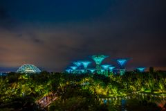 SINGAPORE, SINGAPORE - FEBRUARY 01, 2018: Beautiful outdoor view of futuristic tree of amazing illumination at Garden by Royalty Free Stock Images