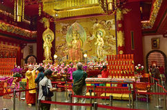 Singapore - February 2015.Buddhist temple interior with altar an Royalty Free Stock Photo