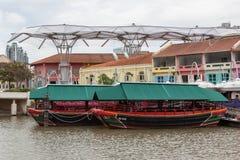 SINGAPORE - FEBRUARY 3 : Large umbrellas at Clarke Quay in Singa Stock Photos