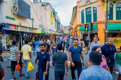 SINGAPORE, SINGAPORE - FEBRUARY 01, 2018: Little India district in Singapore with some people walking in the streets. It. `s Singaporean neighbourhood and Royalty Free Stock Photography