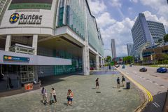 SINGAPORE, SINGAPORE - FEBRUARY 01. 2018: Outdoor view of unidentified people walking in the streets close to a. Conventions and exhibition centre in downtown Stock Image