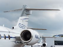 Singapore Airshow 2018. Singapore - February 4, 2018: Tail planes and engines of Gulfstream G280 and G650ER business jets on display during Singapore Airshow at royalty free stock image