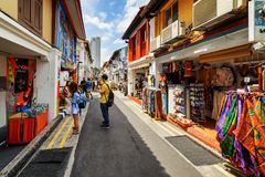 Tourists walking along gift shops at Haji Lane in Singapore. Singapore - February 19, 2017: Tourists walking along gift shops at Haji Lane. Amazing street at the Stock Image