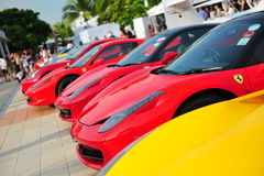 Singapore Ferrari Club Owners showcasing their Ferrari cars during Singapore Yacht Show at One Degree 15 Marina Club Sentosa Cove. SINGAPORE - APRIL 12 Stock Images