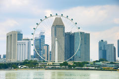 Singapore Ferries Wheel and skyscrapers royalty free stock photography