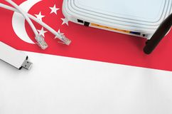 Free Singapore Flag Depicted On Table With Internet Rj45 Cable, Wireless Usb Wifi Adapter And Router. Internet Connection Concept Stock Photography - 165868862