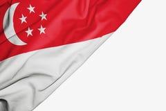 Singapore flagga av tyg med copyspace f?r din text p? vit bakgrund royaltyfri illustrationer