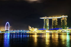Singapore Flyer and Artscience museum and Marina Bay Sands night Stock Photos