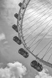 The Singapore Flyer in black and white. A dramatic rendition of the iconic Singapore Flyer, located in the Marina Bay waterfront of Singapore. The steel pylons Stock Photography