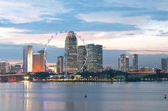 Singapore Flyer and Cityscape at dusk Stock Photography