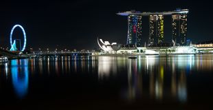 Singapore flyer and marina bay sands at night Royalty Free Stock Image