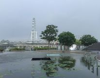 Singapore flyer in rain. Marina bay sands, view to Singapore flyer, raining, cabin, attraction, sightseeing, sightseen, hight, evening, clouds, cloudy, drops Stock Photos