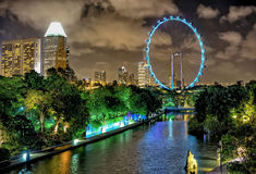 Singapore Flyer and skyline of Downtown Core at Marina Bay Stock Photos