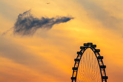 Singapore flyer with sunrise morning sky cloud. Stock Photos