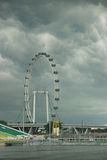 Singapore flyer under clouds Stock Photography