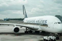 Singapore flygbolag på Changi flygplatsterminal 1 Fotografering för Bildbyråer