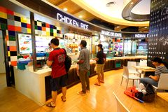 Singapore: Food court. A food court (in Asia-Pacific also called food hall)[1] is generally an indoor plaza or common area within a facility that is contiguous stock image