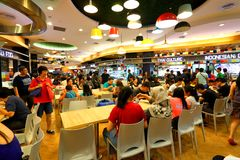Singapore: Food court. A food court (in Asia-Pacific also called food hall)[1] is generally an indoor plaza or common area within a facility that is contiguous Stock Photography
