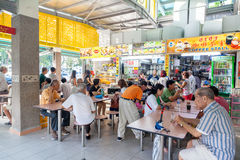 Singapore Food Court at Whampoa Hawker Center. Diners eat at the popular food stalls in Whampoa Hawker Center in Singapore. Hawker centers are inexpensive, open royalty free stock photography