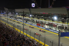 Singapore Formula 1 main raceday. Singapore – September 20, 2015 : F1 drivers line up in their starting grids at Singapore Street Circuit Formula 1 Grand Prix Royalty Free Stock Image