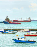 Singapore harbor full of ships. Ships and boats in Singapore harbor in the day Stock Photos