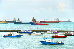 Singapore harbor. Ships and boats in Singapore harbor in the day Stock Photography