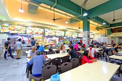 Singapore Hawker center. Singapore Diners eat at the Hawker Center or coffee shops .Hawker centers are inexpensive, open-air food courts popular in Singapore and royalty free stock photo