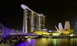 Singapore Helix Bridge and Marina Bay Sands Hotel at Night Stock Photography
