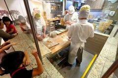 Singapore: Het maken van Dim Sum Stock Afbeelding