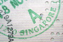Singapore immigration. Stamp closeup fragment royalty free stock image