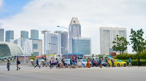 People crossing the road. Singapore Stock Photos