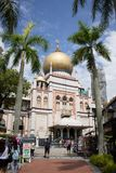 Singapore - 30 Jan 2015: Tourists are walking around Sultan Mosque, a famous mosque in Singapore royalty free stock images