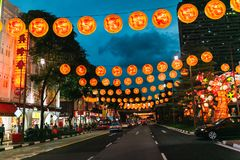 SINGAPORE - JAN 19, 2016: view of city street decorated with lanterns Stock Images