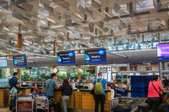 Air New Zealand check-in counter with passengers in Singapore Changi Airport. Singapore - January 2019: Air New Zealand check-in counter with passengers in royalty free stock image