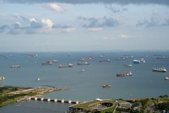Anchorage area panorama opposite Gardens by the Bay with many ships on an anchorage. Singapore, January - 2019: anchorage area panorama opposite Gardens by the stock images