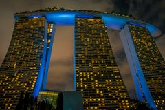 SINGAPORE, SINGAPORE - JANUARY 30, 2018: Beautiful below view of Marina Bay Sands at night the largest hotel in Asia. It Stock Photos