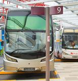 Bus parking at airport. Singapore. SINGAPORE - JANUARY 13, 2017: Bus parking at Changi International Airport. Changi Airport serves more than 100 airlines Royalty Free Stock Image