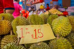 SINGAPORE, SINGAPORE - JANUARY 30. 2018: Close up of durian fruit, the famous tropical fruit in asian countries with its. Thorny skin but delicious and tasty royalty free stock photos