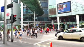 Tourists walk along Orchard Road Singapore. Singapore - January 08, 2018: Crowded tourists walk along Orchard Road. Orchard Road is Singapore's retail heart stock video footage