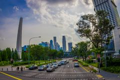 SINGAPORE, SINGAPORE - JANUARY 30. 2018: Outdoor view of some cars, street and Urban scene in the central district of. Singapore Stock Photo