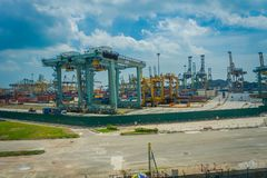SINGAPORE, SINGAPORE - JANUARY 30, 2018: Outdoor view of some metallic structures at the Port of Singapore. Ship-to. Shore STS gantry cranes at shipping yard Royalty Free Stock Image