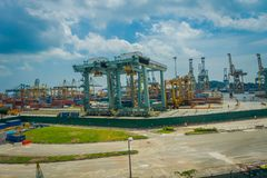SINGAPORE, SINGAPORE - JANUARY 30, 2018: Outdoor view of some metallic structures at the Port of Singapore. Ship-to. Shore STS gantry cranes at shipping yard Stock Photo