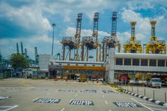 SINGAPORE, SINGAPORE - JANUARY 30, 2018: Outdoor view of some trucks at the enter of terminal of Port of Singapore. Sentosa Island and Keppel Harbour are Royalty Free Stock Photos