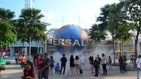 SINGAPORE - JANUARY 13 Tourists and theme park visitors taking pictures of the large rotating globe fountain in front of Universal stock video footage