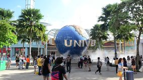 SINGAPORE - JANUARY 13 Tourists and theme park visitors taking pictures of the large rotating globe fountain in front of Universal stock video